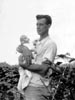 BISHER, Harold Earl holding one of his babies